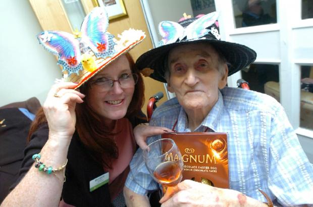 Breme Care Home holds traditional Easter bonnet parade. Sanctuary Care's regional manager Honor Keatley judged the competition, picking resident Bert Warren's creation as the winner.   Buy this photo BMM171402