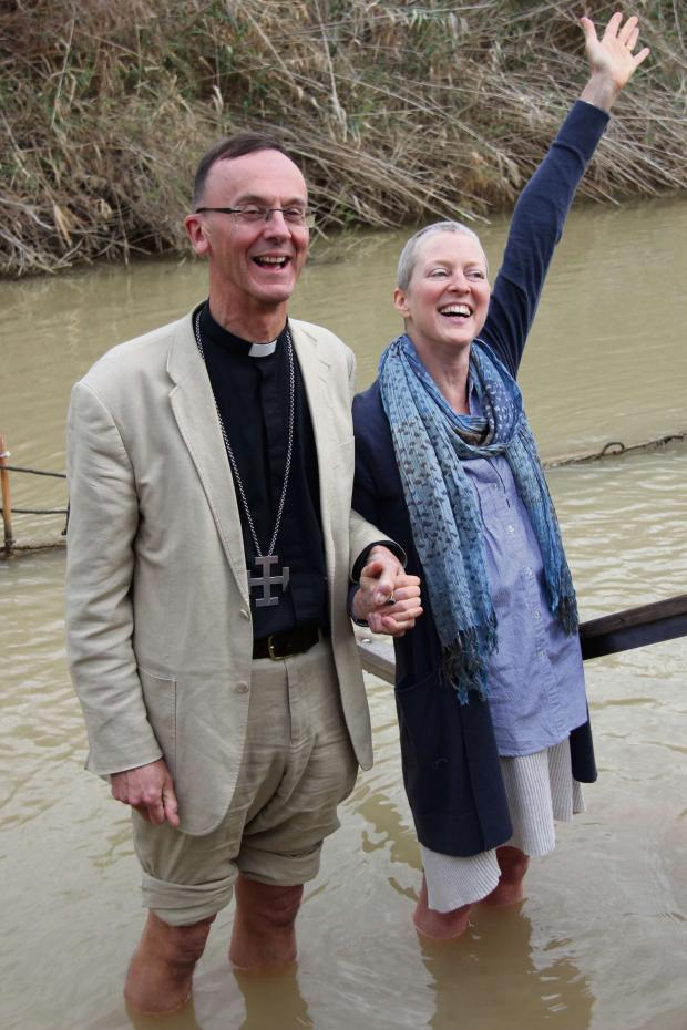 Bromsgrove Advertiser: Denise Inge and Bishop John in the River Jordan, Israel