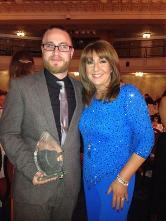 AWARD WINNER: John Rose, from Bromsgrove's Amber Support Services, received a prestigious care award from Jane McDonald. SP