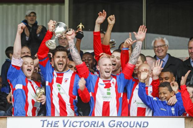 Bromsgrove Sporting's players lift the Smedley Crooke Memorial Charity Cup. Picture: CRAIG ROSS