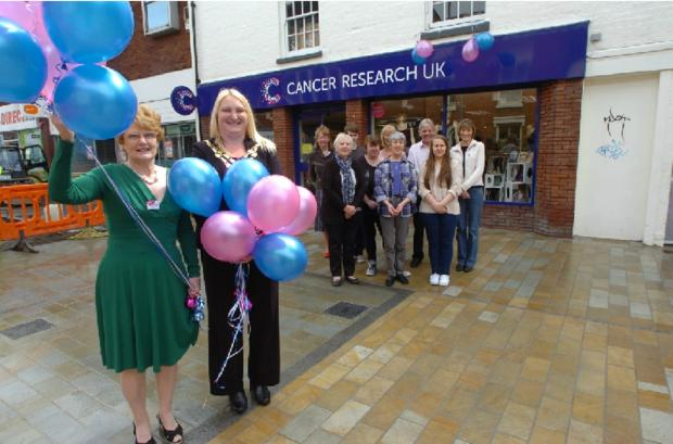 Bromsgrove Advertiser: The Cancer Research UK shop in High Street has had a refurbishment. Manager Maureen Commander, pictured with civic head Helen Jones and the shop's volunteers.   Buy this photo BMM201402a