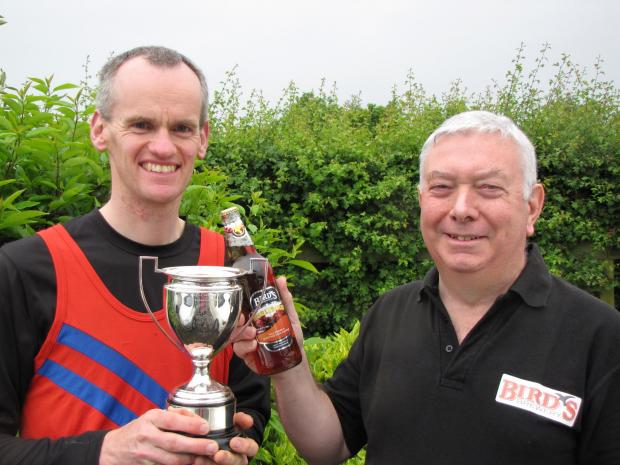 CHARITY CHALLENGE: Timberhonger 10K and the Children's challenge race director Mark Graham, pictured with Steve Hammond from Birds Brewery. SP