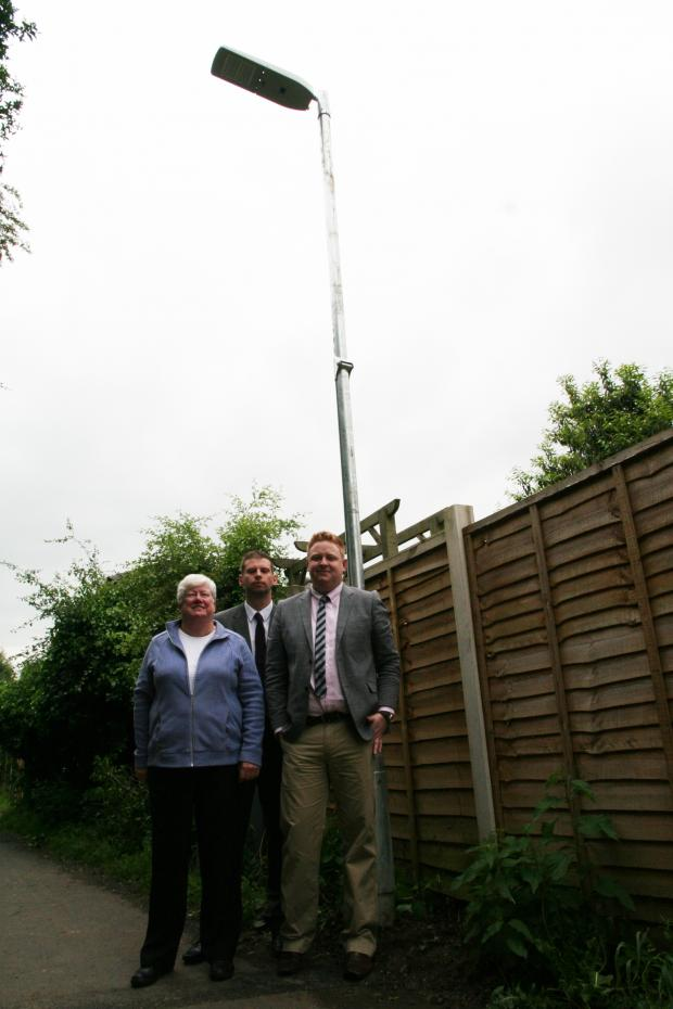 Bromsgrove Advertiser: NEW LIGHTS: County councillor Luke Mallett, pictured with councillors Margaret Buxton and Chris Bloore by the new streetlights. SP