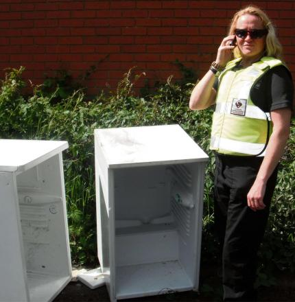 Community safety enforcement officer Lisa Anderson calls in some fridges that have been stripped and fly tipped. SP