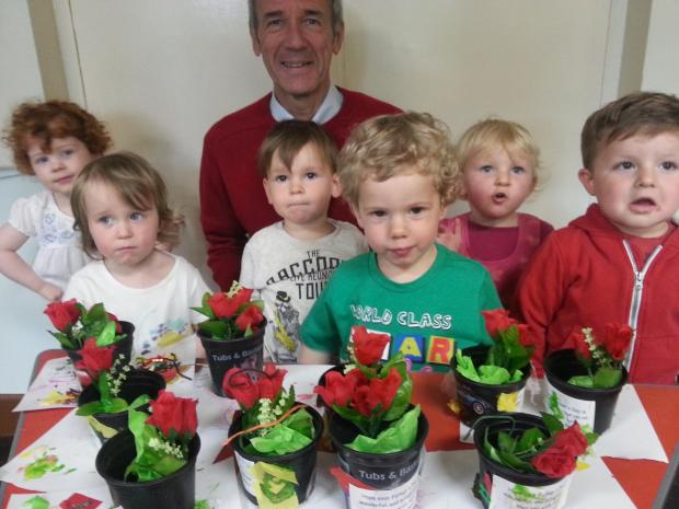 FATHER'S DAY FUN: Youngsters from St Stephen's Church playgroup with John Foulkes who brings along his grandson Harry to the playgroup. SP