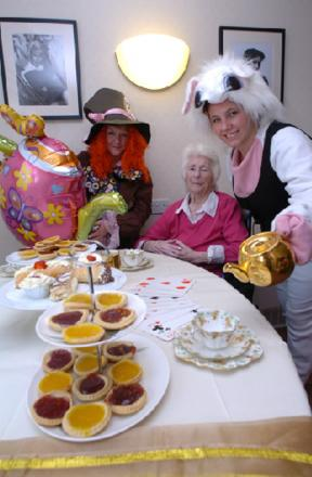 TEA PARTY: Breme Care Home is holding a Mad Hatter's Tea Party for national care home open day. Pictured are Denise Clark, resident Millie Cox and Becky Rudge, deputy manager.   Buy this photo BMM251401b