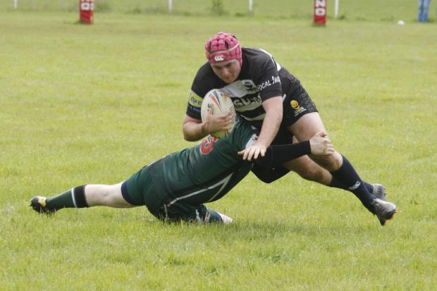 A Ravens player is tackled during Saturday's home defeat to Derby City. Picture: CRAIG ROSS