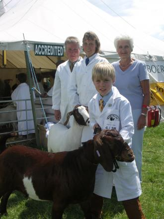 BREEDING BUSINESS: Ready for the parade ring – Rob and Vicky Grinnall, together with their son Daniel (aged) and Rob's mother Ella and two of their British Boer goats.