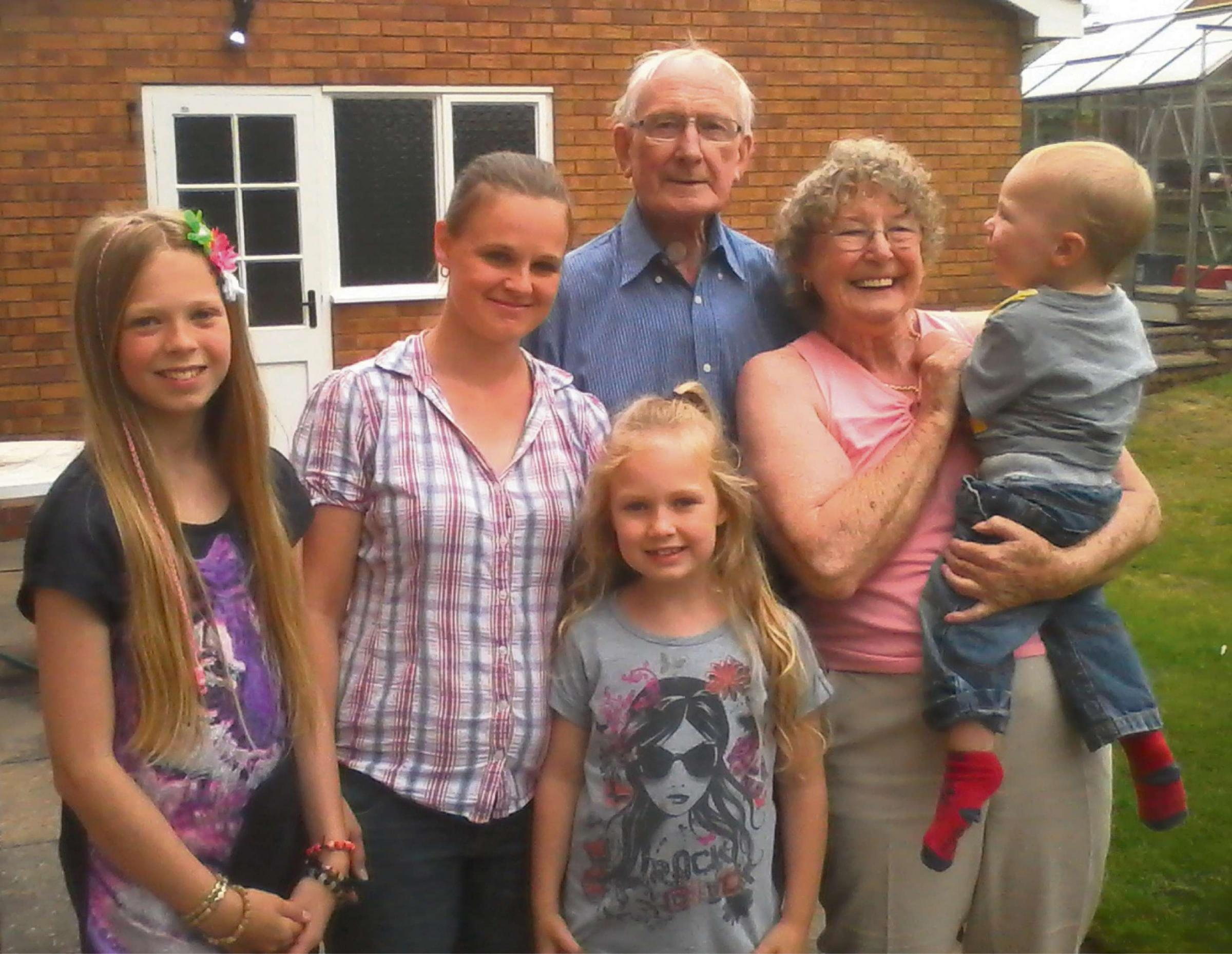 Beryl and John with family members. SP