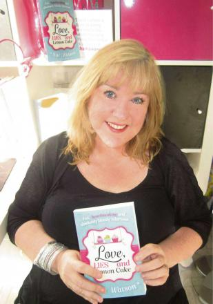 Bromsgrove author Sue Watson with a copy of 'Love, Lies and Lemon Cake'. SP