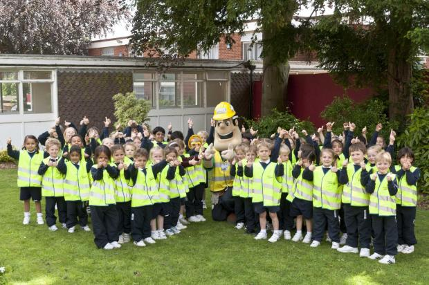Pupils with Considerate Constructors Scheme mascot Ivor Goodsite.