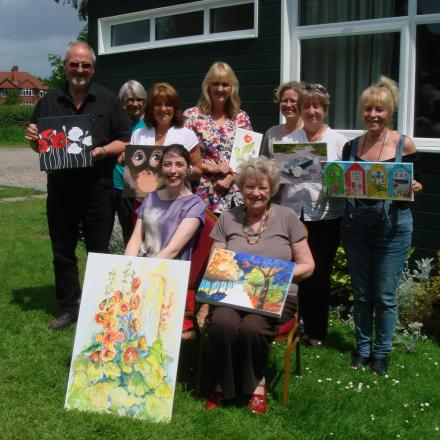 EXHIBITION: Tutor Anne Scrimshaw with some of her class members and their art work. SP