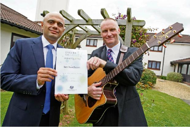 BUSKING BOBBY: PC Ian Northcott received his Point of Light award, recognising his charity work, from Bromsgrove MP Sajid Javid on Friday. Buy photo BCR271402_01Buy photo BCR271402_01