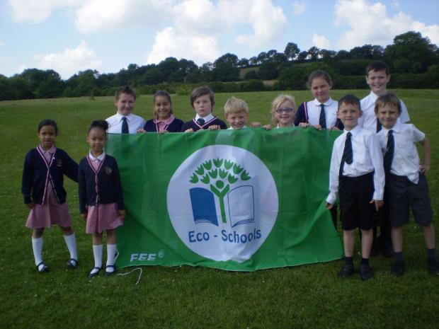 Youngsters at Holywell Primary and Nursery School presenting their green flag.