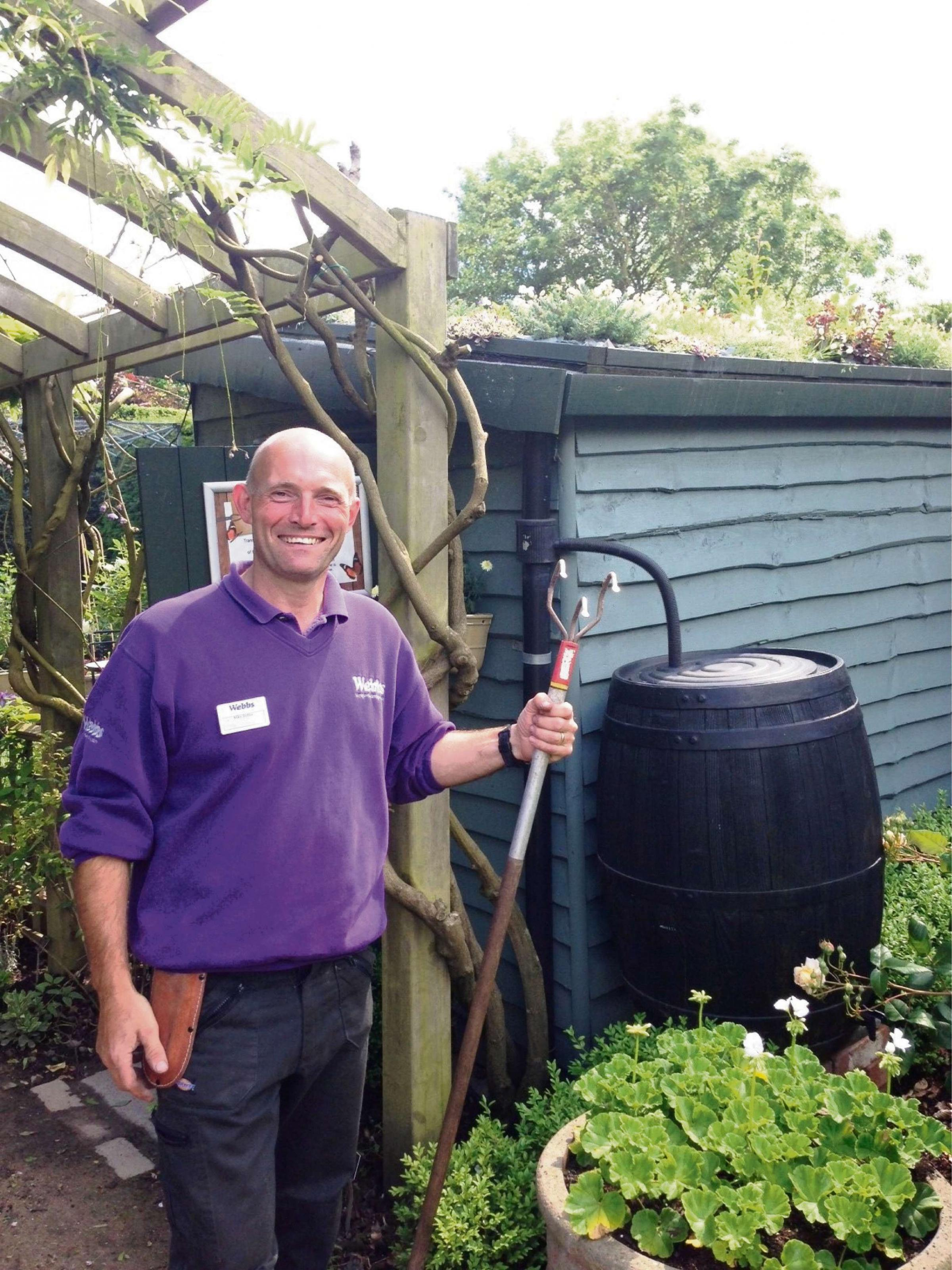 Head gardener Mike Rutter shows off the living shed roof. SP