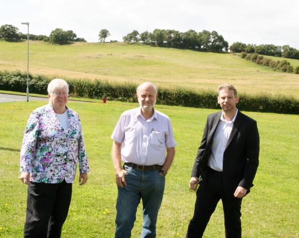 JUBILANT: Councillors Luke Mallett and Margaret Buxton, and Whitford Vale Voice chairman Roy Dixon, were celebrating after the proposal to build hundreds of homes in Whitford was rejected. SP