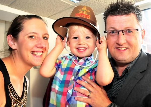WILD WEST: Halesowen youngster Fin Carpenter who raised money for charity at a Bromsgrove class. Pictured with parents Darren and Lucy. SP