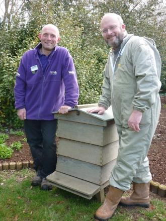 Mike Rutter from Webbs Garden Centre and beekeeper Chris Broad with one of the hives. SP