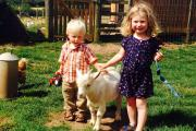 Lilia and Max Halford-Bishop with Belter the pigmy goat, at Chadwich Manor Farm.