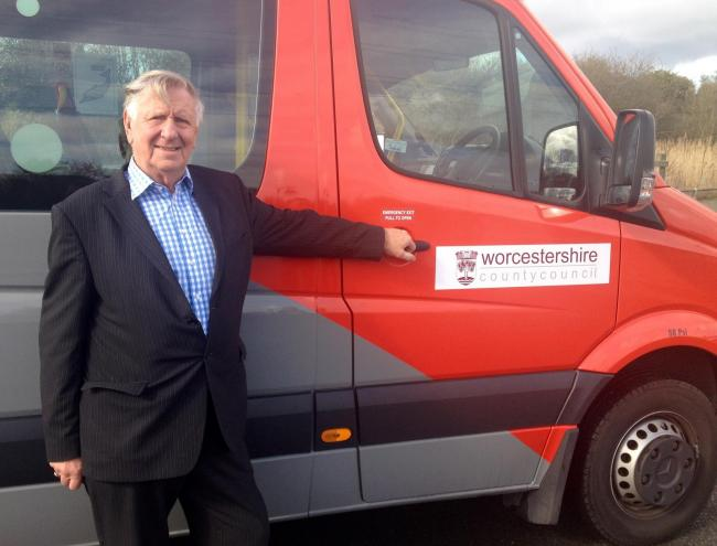 Councillor John Smith with the bus donated by First