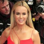 Bromsgrove Advertiser: Amanda Holden lies naked on a bed of cabbages for Peta