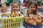 Lola Lightfoot, 3, and Isabella Brenham, 4, with some of the cakes Lola helped to make at home.