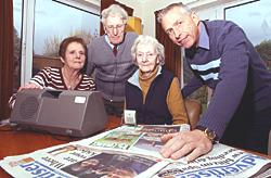 Our turn to make the news: Editor of the Talking Newspaper for the Blind Margaret Brown, with on the left reader Linda Caleb, her husband George and Gerald Hughes. Ref:NT:03789.