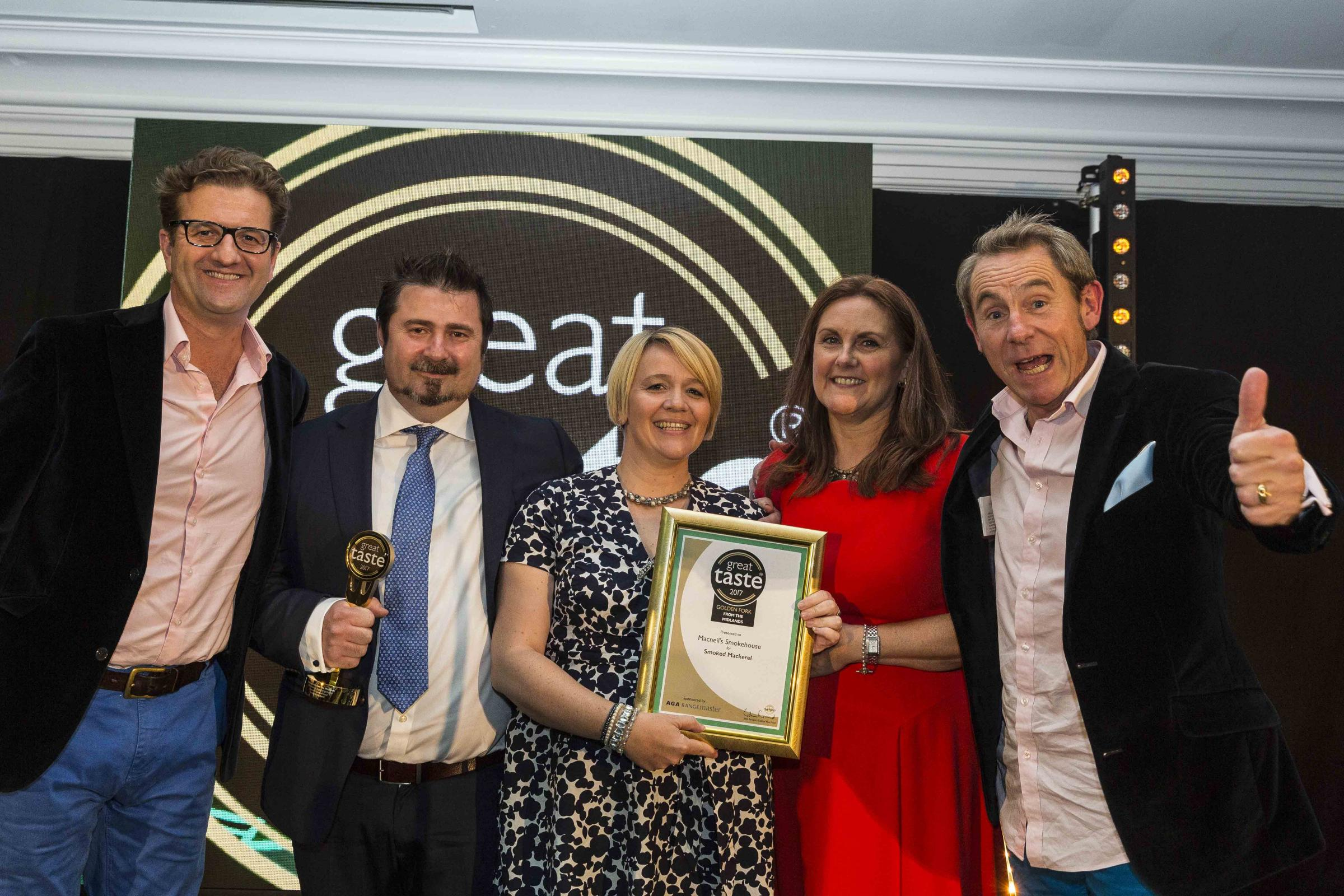 SMOKING: Golden Fork from the Midlands winners.John Farrand from the Guild of Fine Food, Tony and Bee Macneil from Macneil's Smokehouse, Kathryn Lowe from Aga Rangemaster