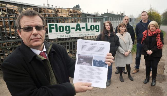 Nick Arkell (left) with one of his leaflets protesting against the plan, alongside Tracy Shillingford, Myfanwy and Cliff Chalenor, Grant Bishop and Parish Cllr Sue Abel