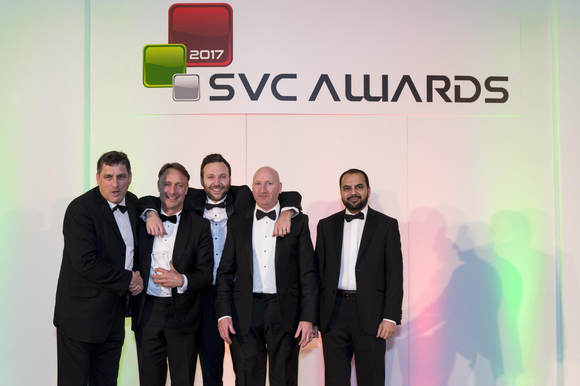 Members of the EBC Group celebrate their award