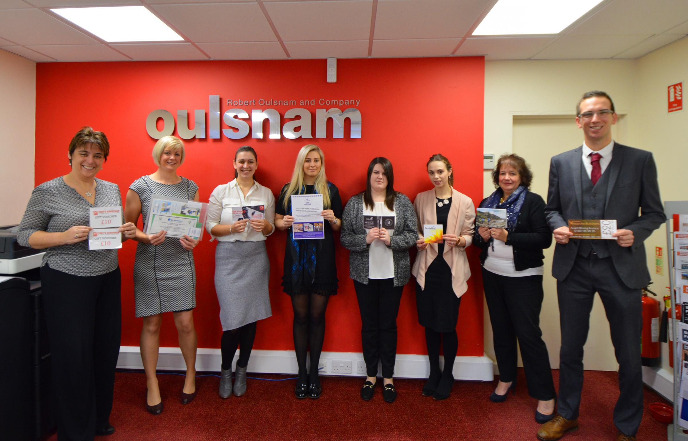 AUCTION: Staff at Oulsnam Lettings in Barnt Green holding up some of the donated gifts