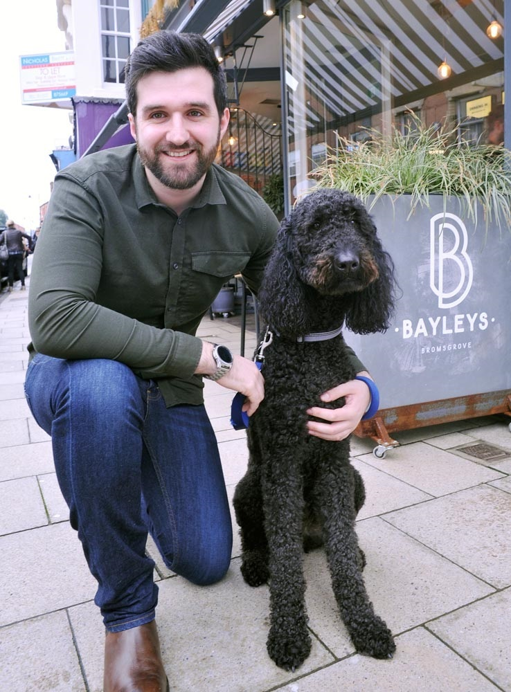 Nick Fisher with goldendoodle Max at dog-friendly Bayley's of Bromsgrove
