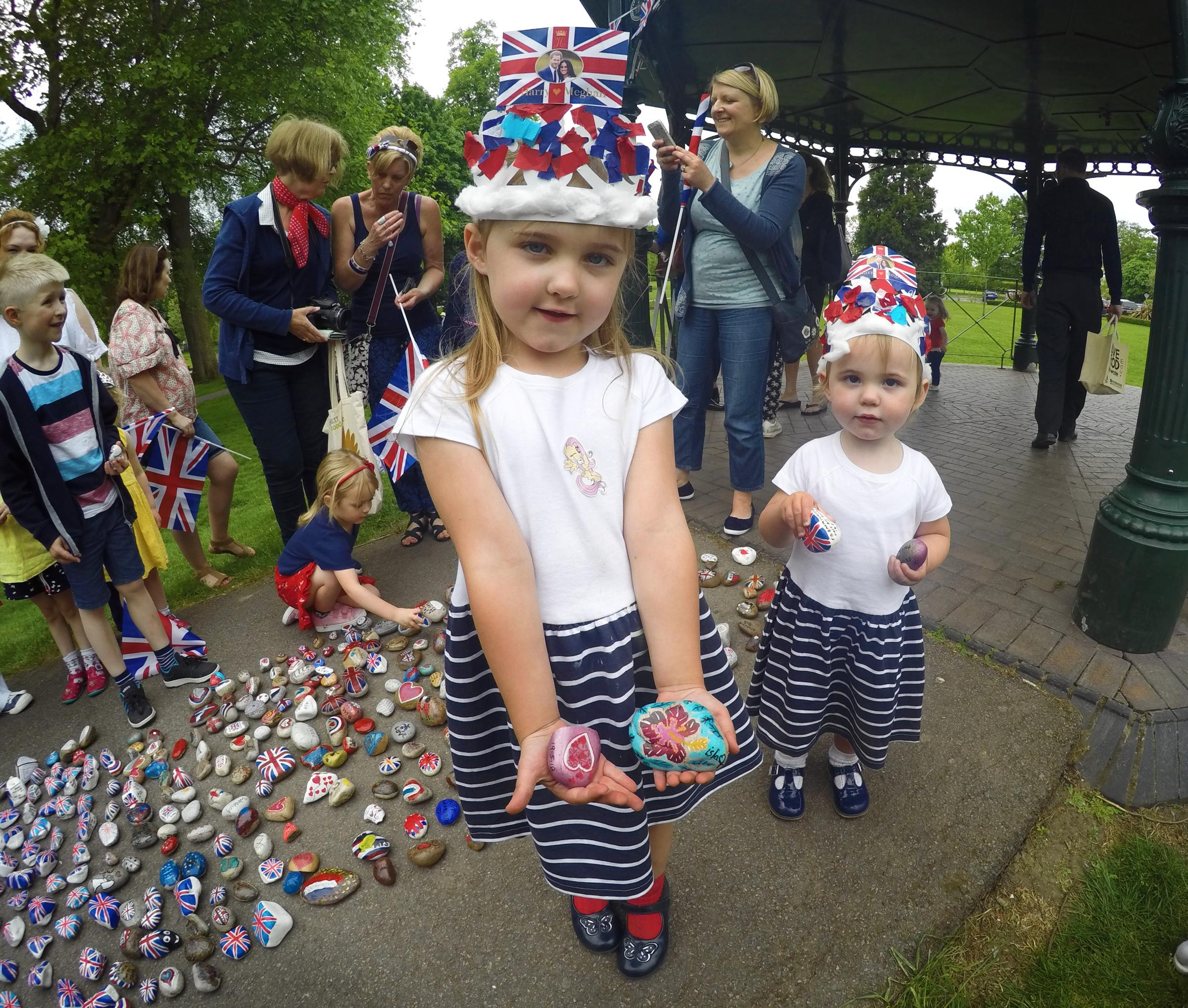 Evie and Erin Bricknell, aged 4 and 2, with their royal wedding-themed rocks