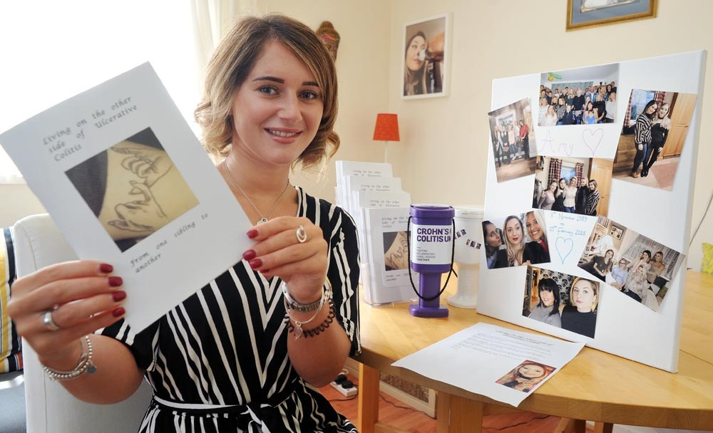 Emily Redhead with her booklet on Ulcerative Colitis, which has been made in memory of her sister Amy