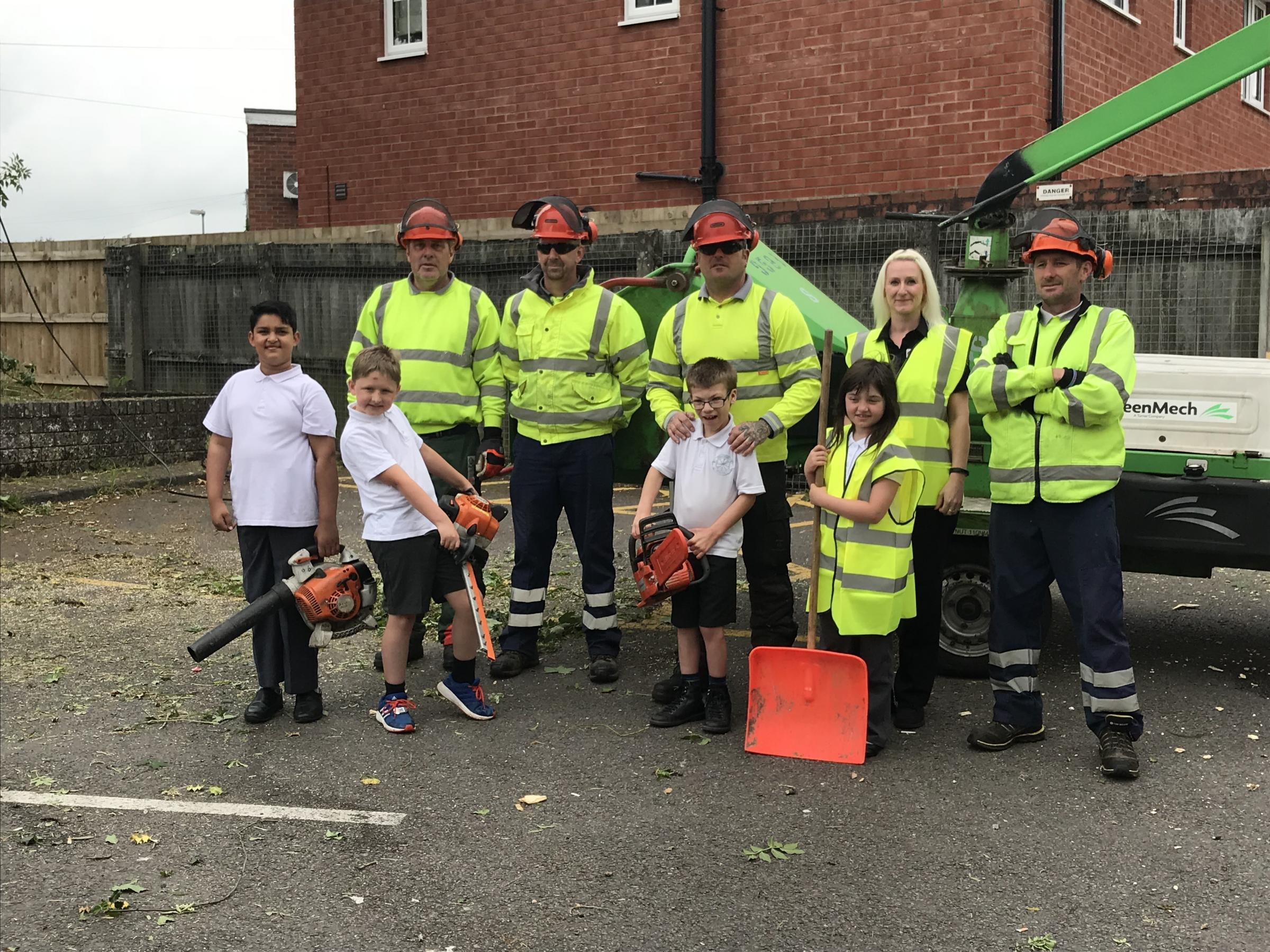 Children from Chadsgrove School helping to clear the area