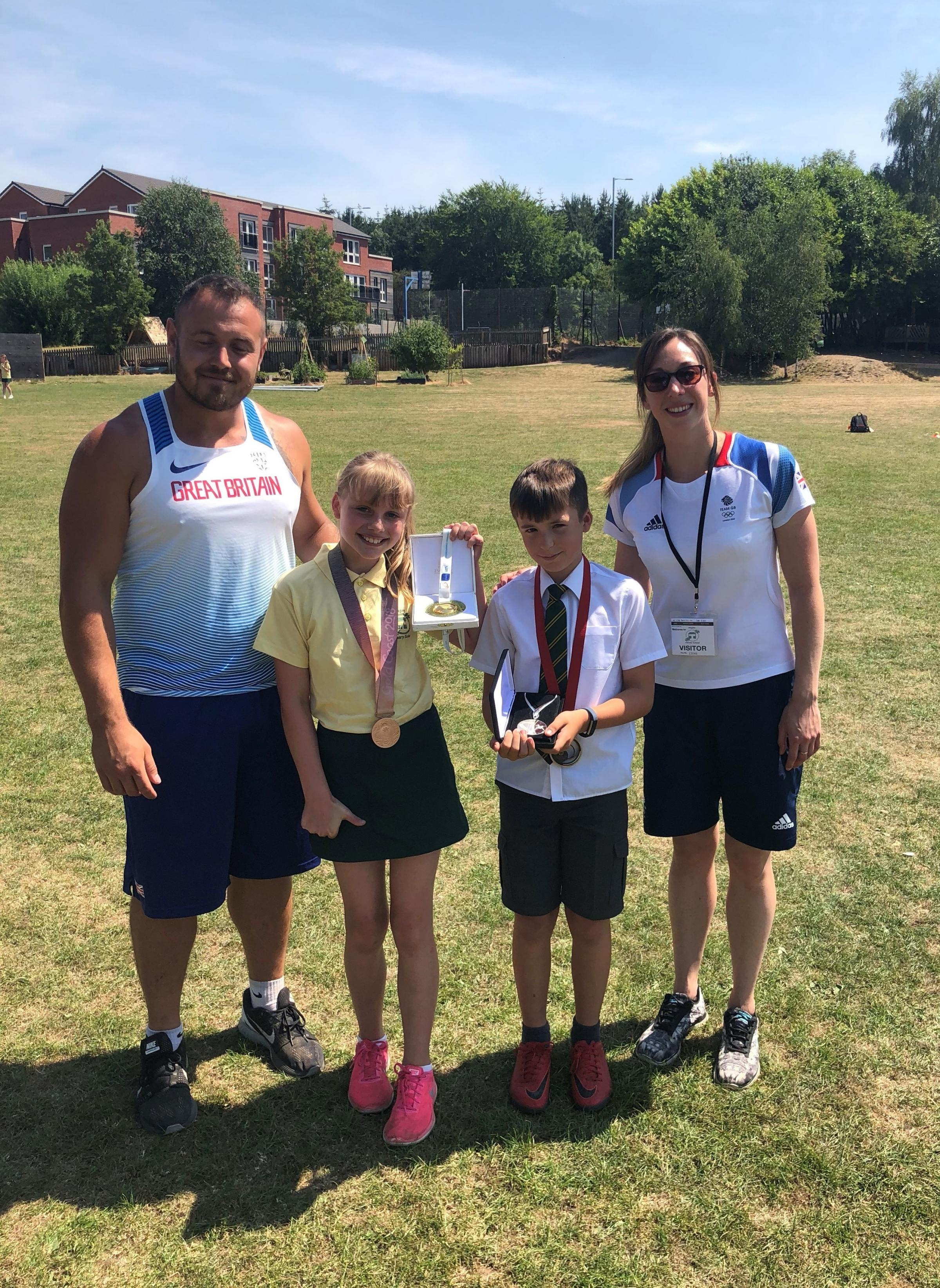 Tamsin White and Charlie Stanley with  athletes Mark Dry and Amy Smith