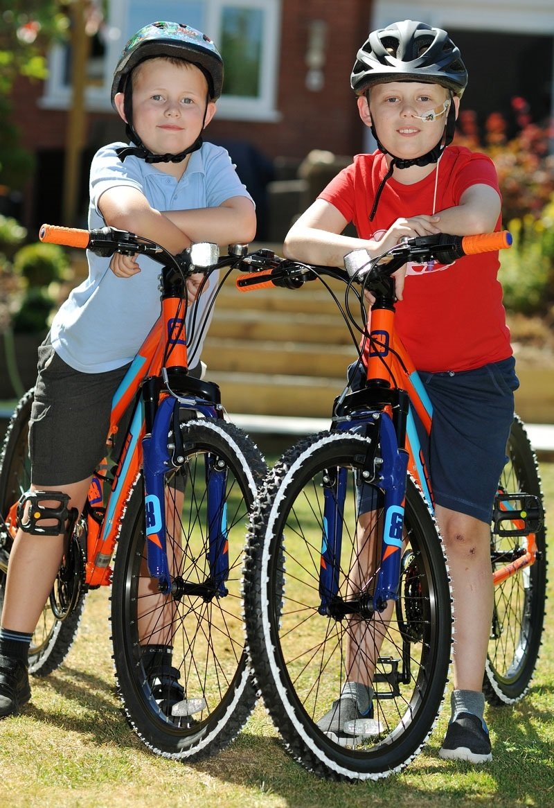 Lewis Portman, age 7, and Oli Portman, age 9, with their new bikes