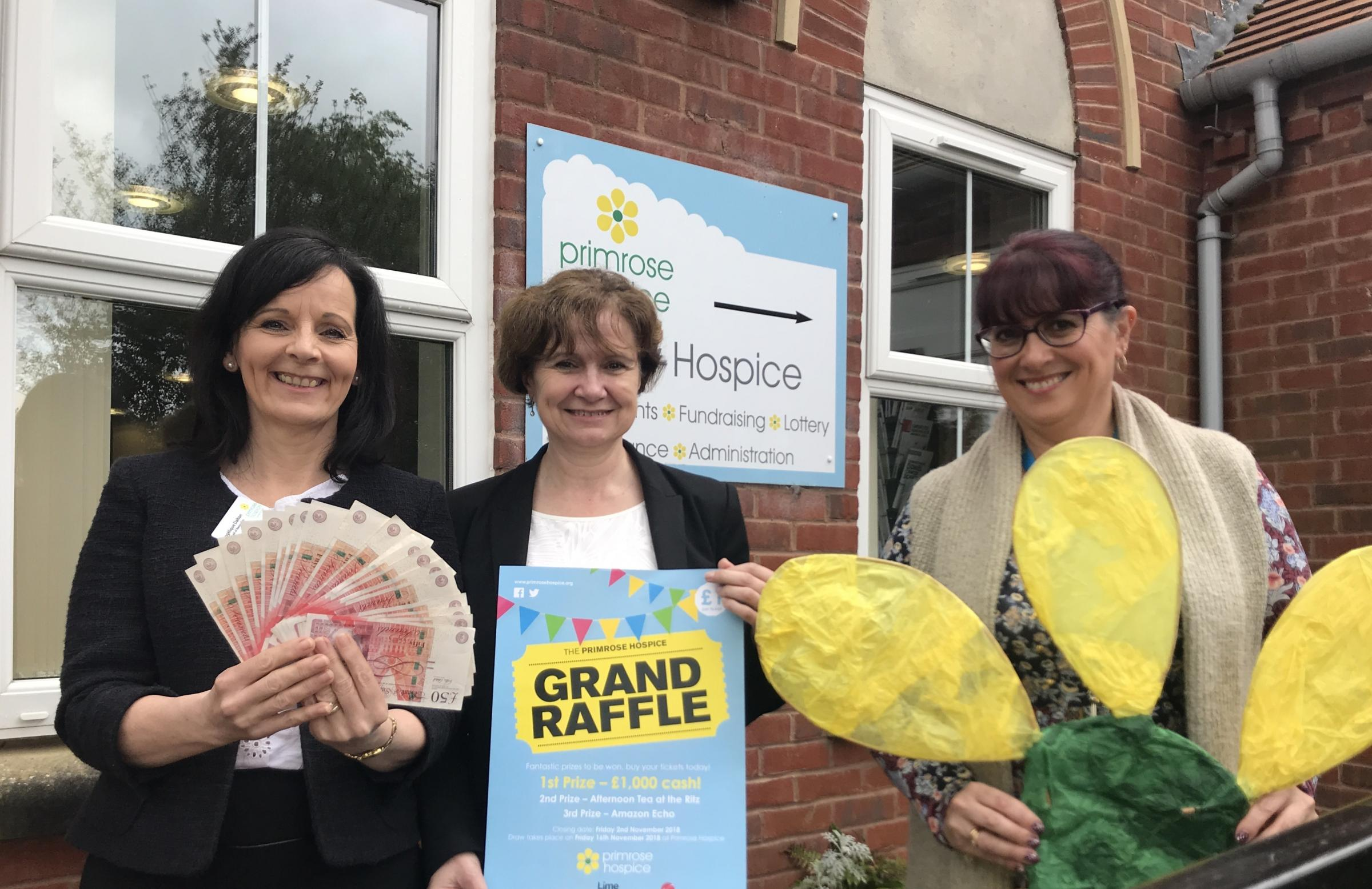 Head of resources Angelique Dalton, Tina Circus from raffle sponsors Thomas Horton LLP Solicitors, and hospice volunteers manager Jo Wright