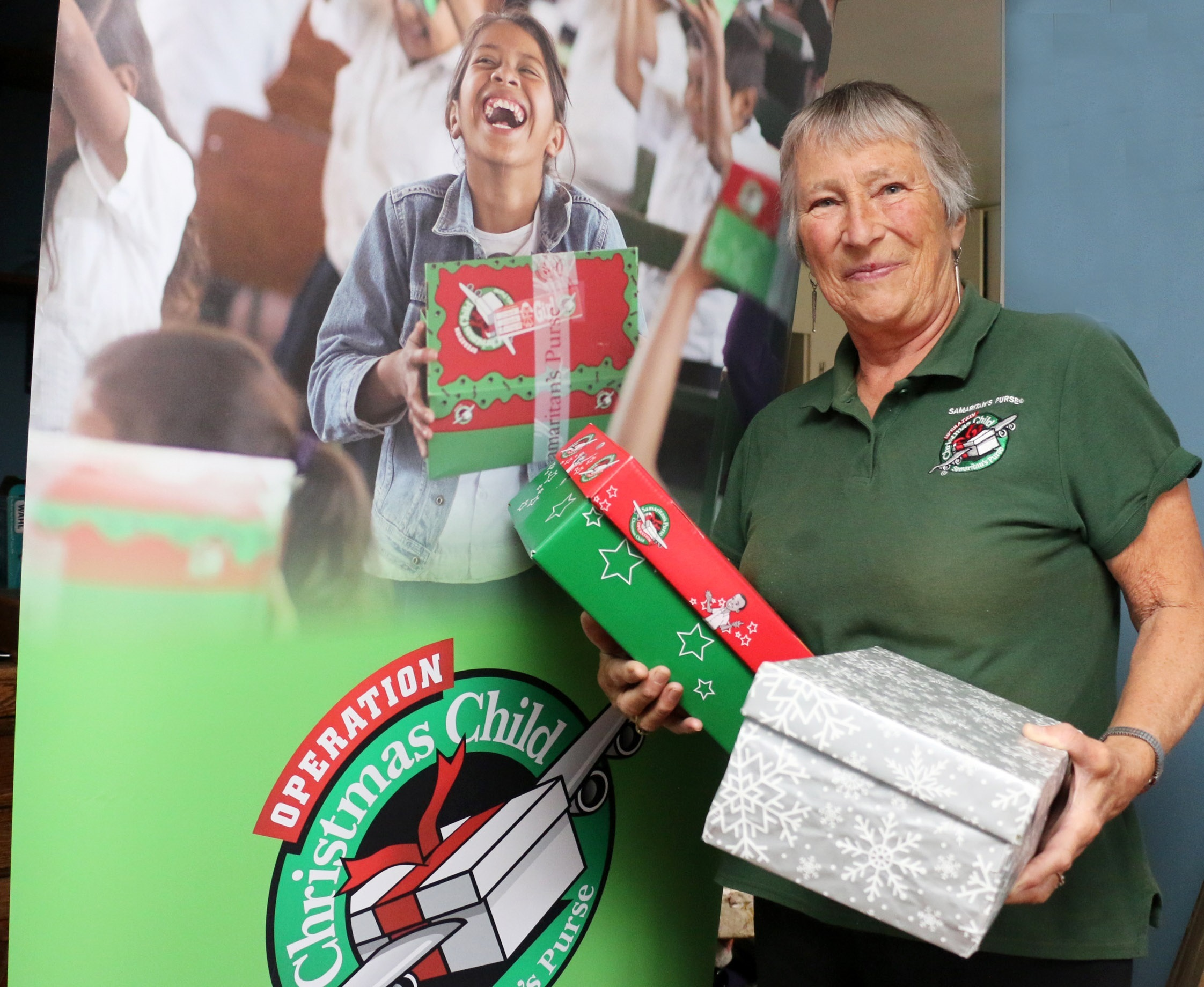 Rosemary Aveyard with shoeboxes for the Operation Christmas Child appeal