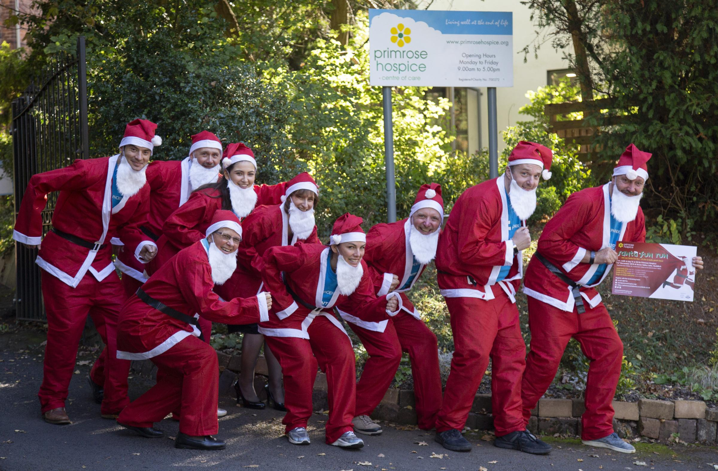 A group of volunteers from The Phoenix Group and staff from Primrose Hospice are getting in the Christmas spirit