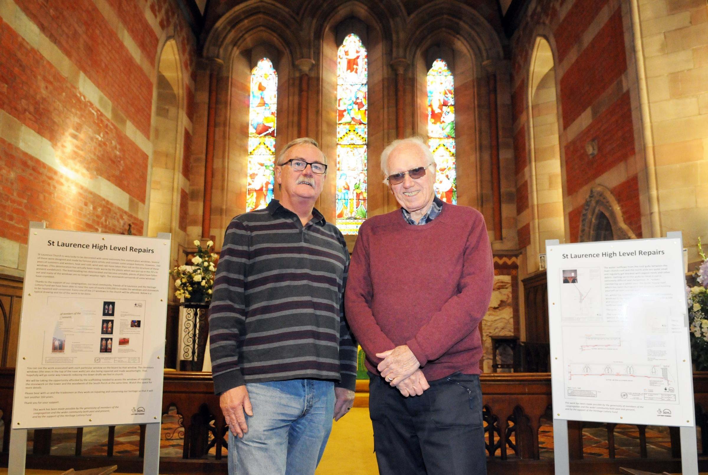Church warden Graham Clark and project manager Bob Dale in front of St Laurence's stained glass windows