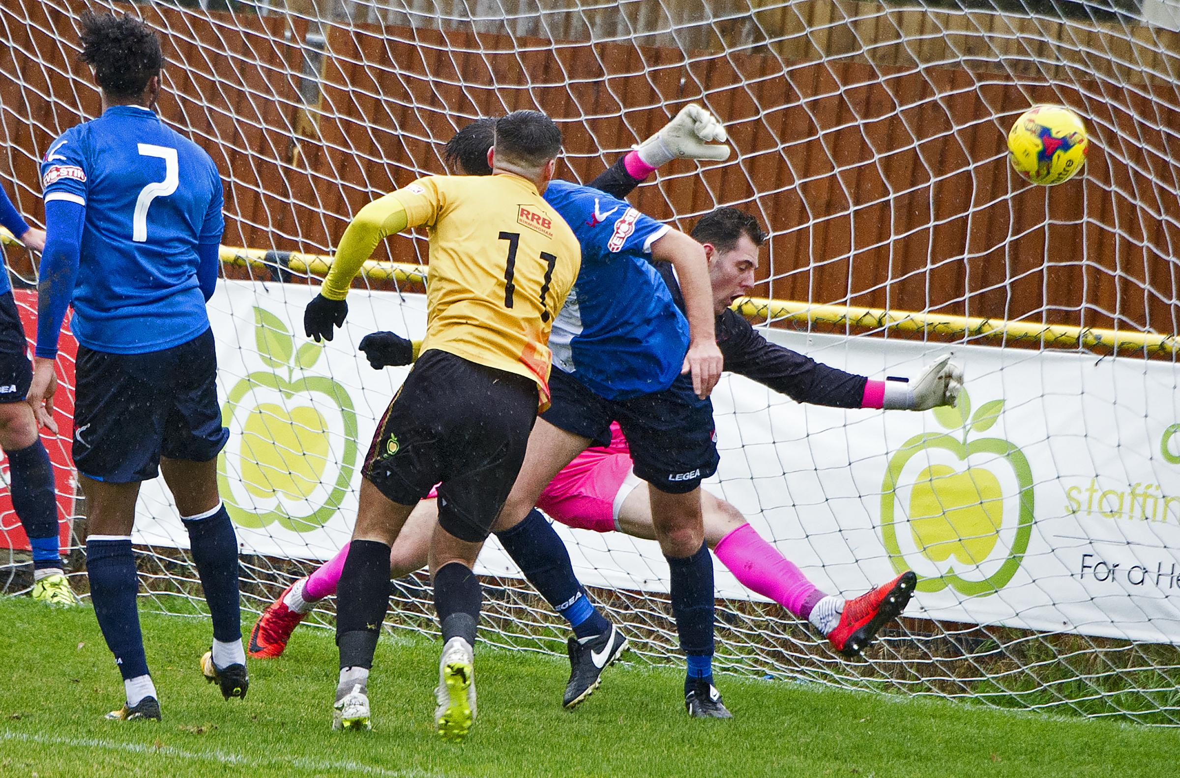 Josh March scores for Alvechurch. Photo by Paul France