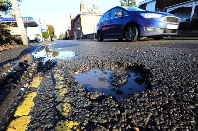 A pothole on Henwick Road in Worcester. Photo: Jonathan Barry