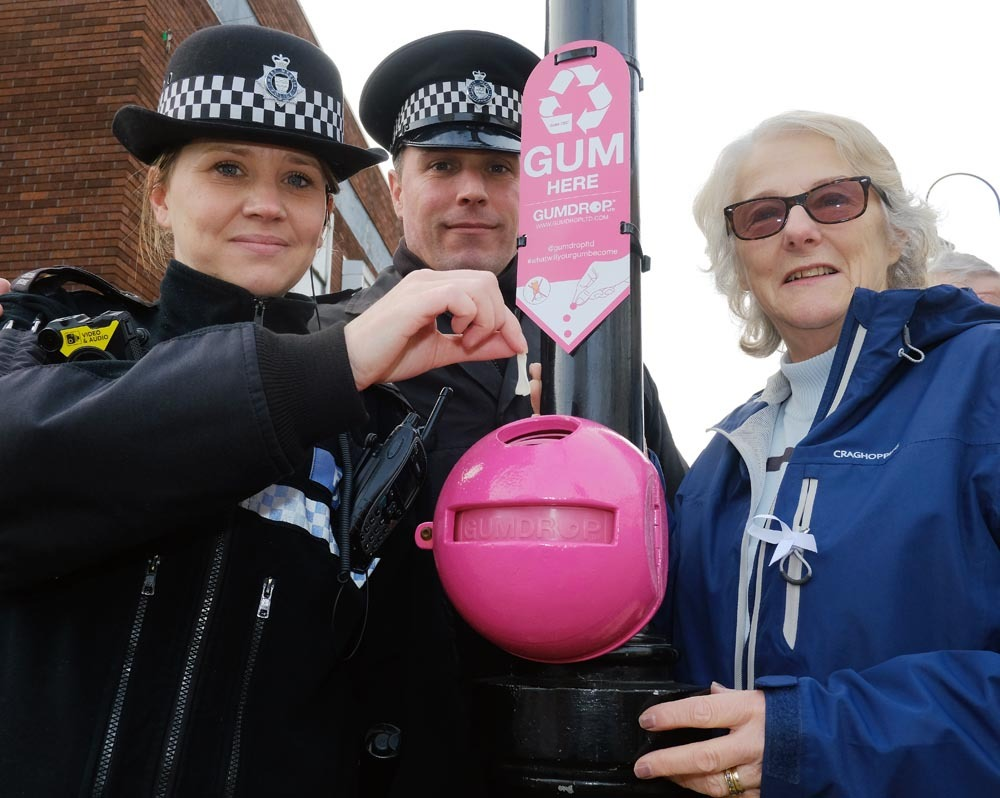 Sgt David King (centre) and Cllr Margaret Sherrey (right) unveiling new chewing gum bins in Bromsgrove today
