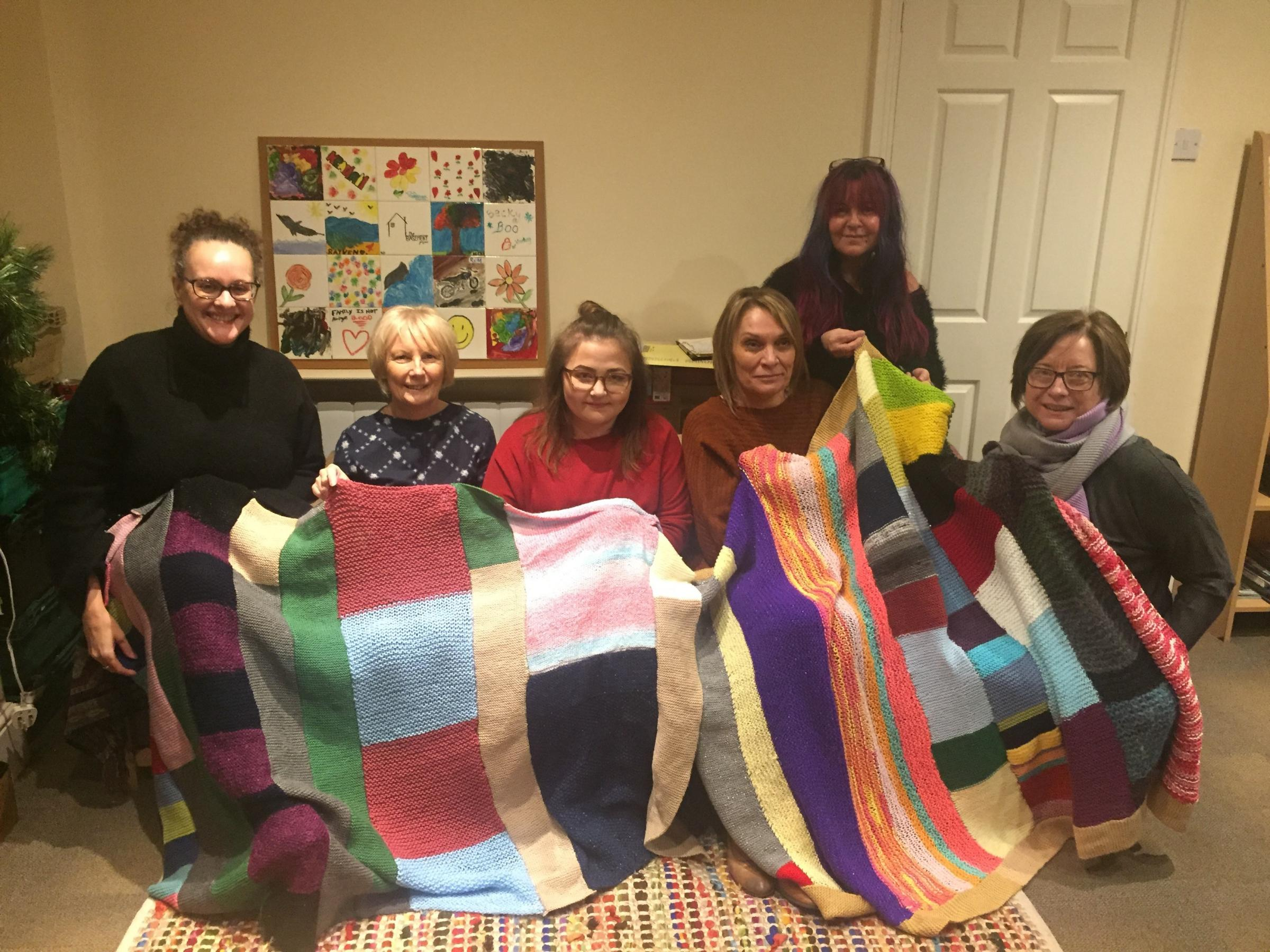 The blankets which were knitted by the foster children at FCA