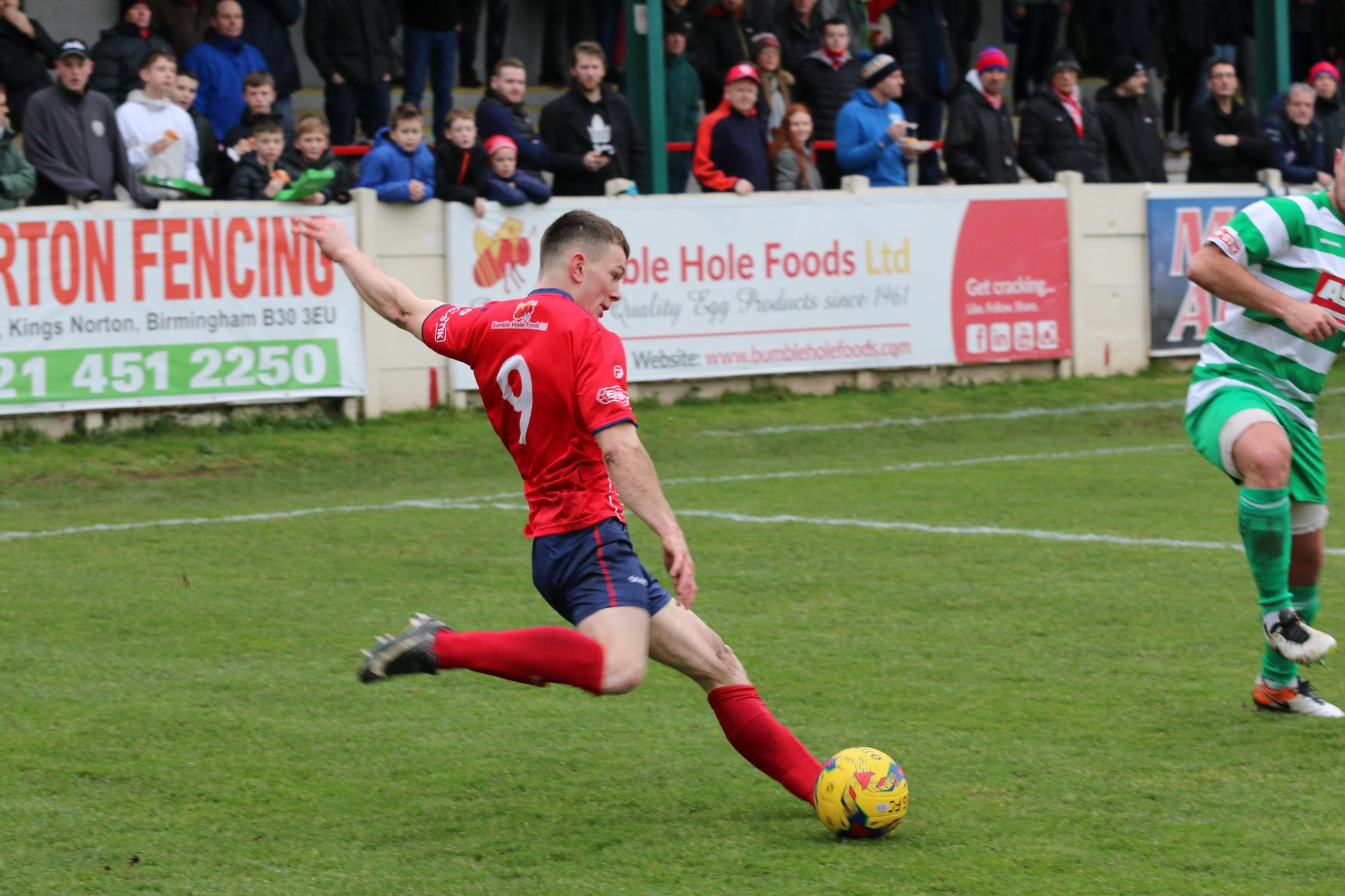 Jason Cowley in action against Thame. Photo: David Besley