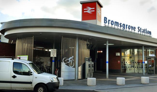 Two teenagers have been charged and remanded after a boy was robbed and threatened with an imitation firearm near Bromsgrove Railway Station.