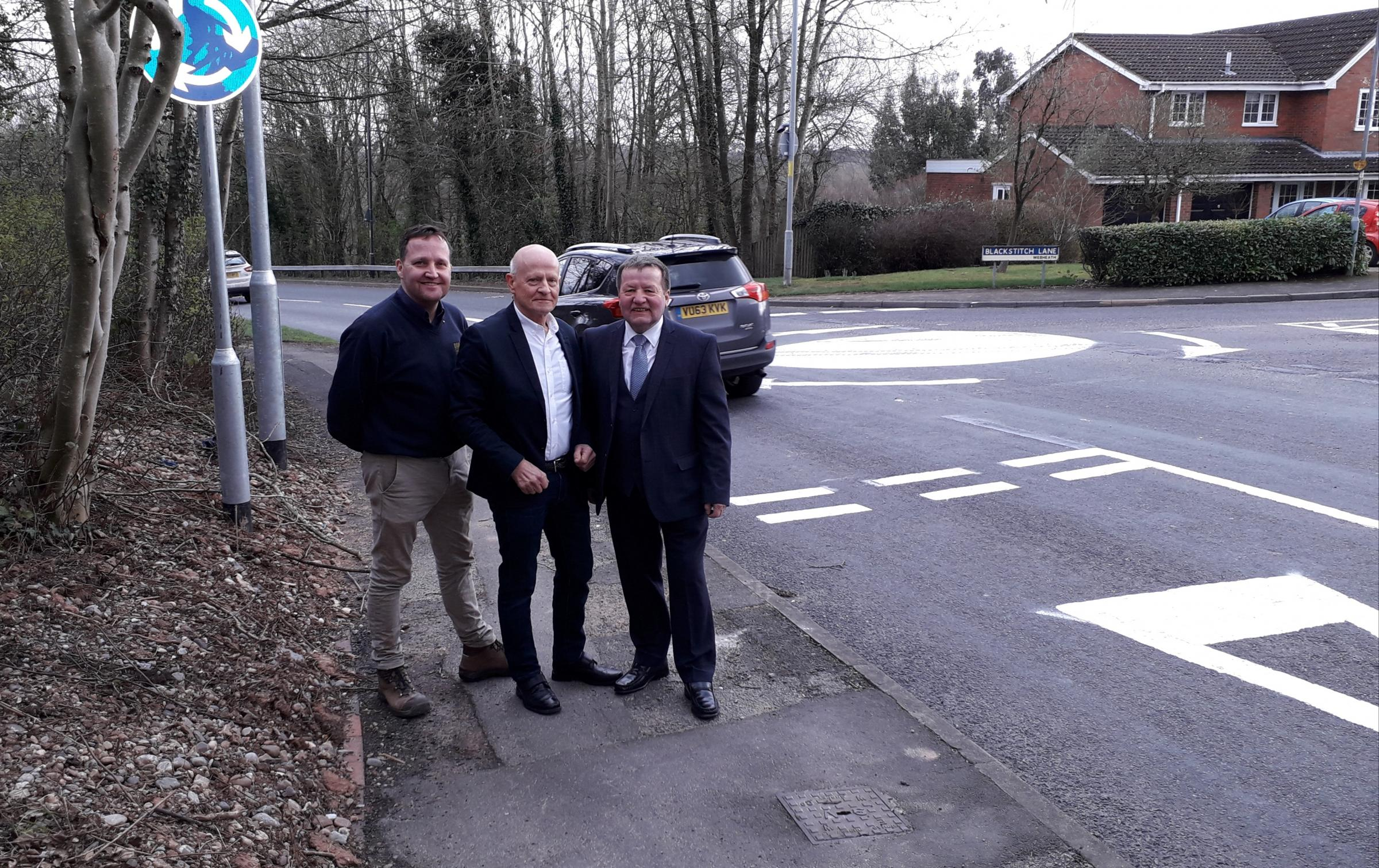 Council leader Matt Dormer, David Thain, and Councillor Brandon Clayton by the new island at the junction of Blackstitch Lane and Middlepiece Drive