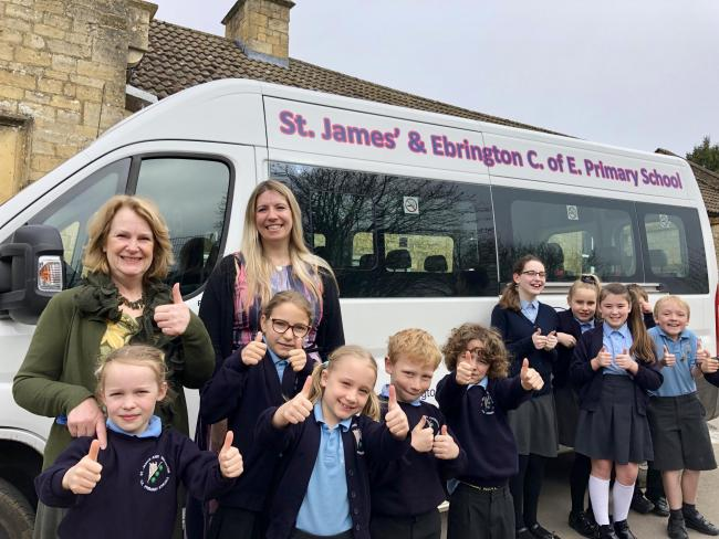 NEW BUS: Lorrie Robertson, assistant headteacher, and on the right is interim executive headteacher, Alexandra Symondson and children with the new minibus