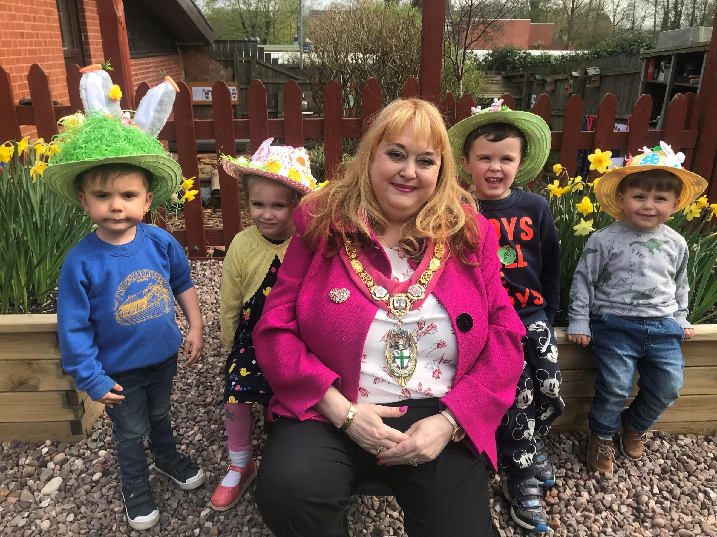Mayor Cllr Juliet Brunner with some of the contestants of the Easter Bonnet Parade.
